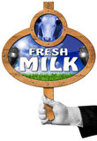 Fresh Milk -  Sign with Hand of Waiter Stock Photography