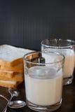 Fresh milk with sliced bread Stock Photos