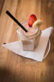Fresh milk, strawberry and banana smoothie drink on wodeen table Stock Photo