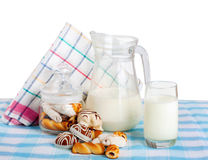 Fresh milk and tasty cookies on blue  tablecloth Royalty Free Stock Image