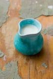 Fresh milk in vintage ceramic jug Stock Photos