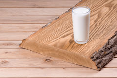 Fresh milk. On a wooden board Royalty Free Stock Photo