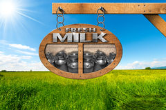 Fresh Milk - Wooden Sign in Countryside Royalty Free Stock Image