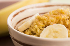 Fresh millet porridge with banana Stock Photography