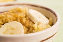 Fresh millet porridge with banana Stock Image