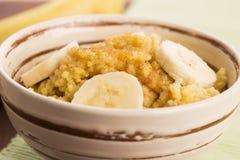 Fresh millet porridge with banana Stock Images