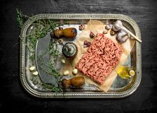 Fresh minced meat with garlic and spicy herb. On the black chalkboard Royalty Free Stock Images