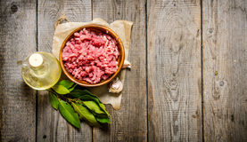 Fresh minced in a wooden Cup with onion and Bay leaf. Stock Photos