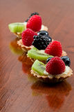 Fresh mini fruit tarts Stock Photo