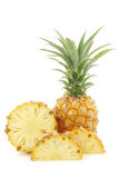 Fresh mini pineapple fruit and a cut one Stock Image