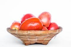 Fresh Mini Plum Tomato In Rattan Basket Royalty Free Stock Photos