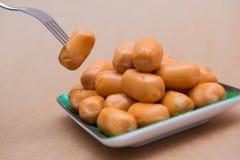 Fresh mini sausage in dish Stock Image
