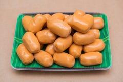 Fresh mini sausage in dish Stock Images