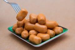 Fresh mini sausage in dish Stock Photo