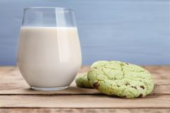 Fresh mint chocolate chip cookies and glass of milk Stock Image