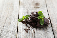 Fresh mint. With chocolate on grey wooden background stock image