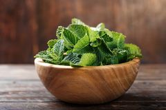 Fresh mint. In a wooden plate on a wooden background Stock Photography