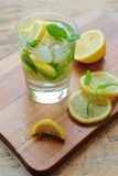 Fresh mint leafs and ice water with lemons Royalty Free Stock Photo