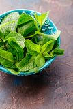 Fresh mint leaves in the ceramic bowl stock image