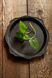 Fresh mint leaves on an old tray on wooden table Royalty Free Stock Photos