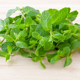 Fresh mint leaves on wooden board. Stock Images