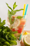Fresh mint on the wood table with lemons and lemonade Stock Photos