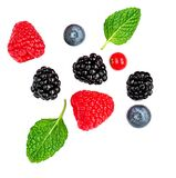 Fresh Mix  Berries Isolated On White Background. Strawberry, Raspberry, Cranberry, Blueberry And Mint Leaf, Flat Lay. Top View Royalty Free Stock Photo