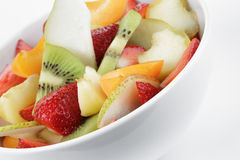 Fresh mix fruit salad with strawberry, kiwi and peach Stock Images