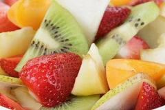 Fresh mix fruit salad with strawberry, kiwi and peach Royalty Free Stock Images