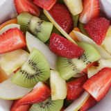 Fresh mix fruit salad with strawberry, kiwi and peach Royalty Free Stock Photos