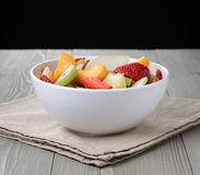 Fresh mix fruit salad with strawberry, kiwi and peach Stock Photos