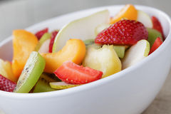 Fresh mix fruit salad with strawberry, kiwi and peach Royalty Free Stock Image
