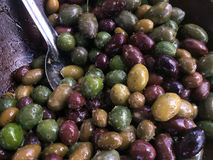 Fresh mix of olives on display in the market Stock Image