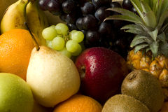 Fresh mix of organic fruit. Fresh organic mixed fruit in a cardboard box Royalty Free Stock Photos