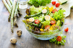 Fresh mix salad with green asparagus and eggs for healthy snack Royalty Free Stock Photography