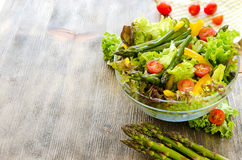 Fresh mix salad with green asparagus for healthy snack Royalty Free Stock Photography