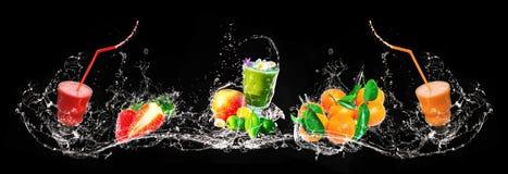 Fresh mix of smoothies and fruit, splashing, banner. Fresh mix of smoothies and fruit, splashing on black background as banner royalty free stock image