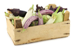 Fresh mixed aubergines(Cucurbita pepo) in a wooden crate Royalty Free Stock Photo