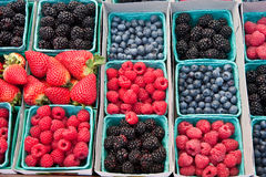 Fresh mixed berries. Blackberries blueberries strawberries and raspberries creating a pattern. raspberries are the focus point Stock Photo