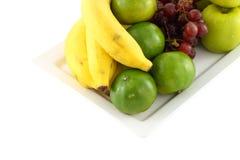 Fresh mixed fruit focus green orange Royalty Free Stock Photography