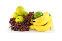 Fresh mixed fruit in plate Stock Images