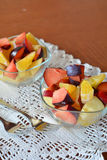 Fresh mixed fruit salad in the bowl Royalty Free Stock Photos