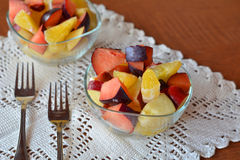 Fresh mixed fruit salad in the bowl Stock Photos