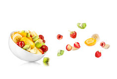 Fresh mixed fruit salad falling Royalty Free Stock Images
