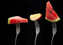 Fresh mixed fruit on stainless fork Stock Photography