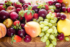 Fresh mixed fruits, berries background.Healthy eating.Love fruit, diet. Stock Photos