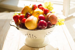 Fresh mixed fruits, berries in bowl. Love fruit, berry. Sunlight Stock Image
