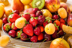 Fresh mixed fruits, berries on plate. Summer fruit, berry. stock images