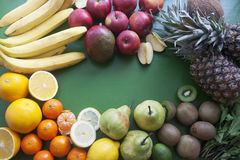 Fresh mixed fruits. On the green background Stock Image