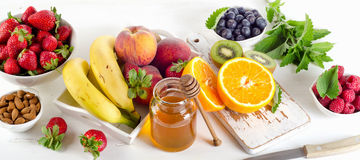 Fresh mixed fruits, honey and berries. Royalty Free Stock Photography